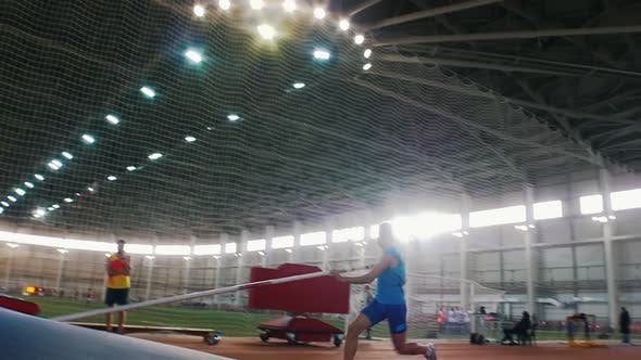 Thumbnail for Pole Vault Training in the Stadium - a Young Man Jumping Over the Bar