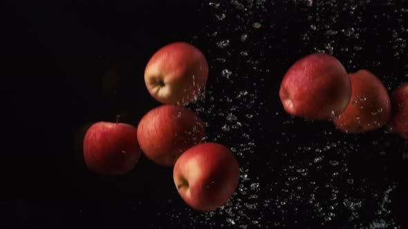 Thumbnail for Red Apples with Water Droplets Collide on Black Background. Fruits Falling Into Water. Red Prince
