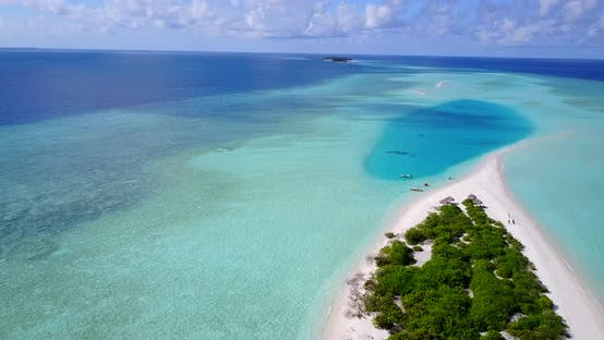 Thumbnail for Beautiful fly over travel shot of a white paradise beach and blue water background in high resolution
