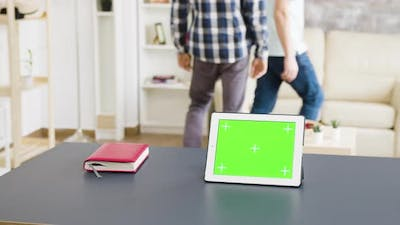 Medium Shot of Tablet with Green Screen on the Table