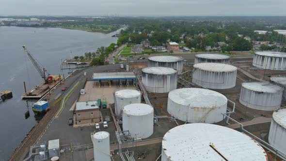 Aerial view close up Industrial view at oil refinery plant form industry zone with oil tank