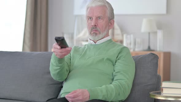 Thumbnail for Old Man Watching TV at Home