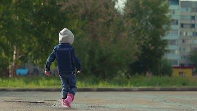 Child in Rubber Boots, Denim Jacket