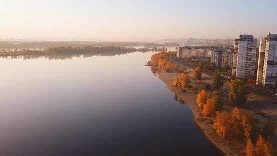 Thumbnail for Flight Over the Bay in Autumn, Yellow Foliage and City Outskirts. Ukraine, Kiev