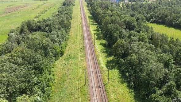 Thumbnail for Train Way, Railroad tracks Through Green Grassed Countryside, Aerial.