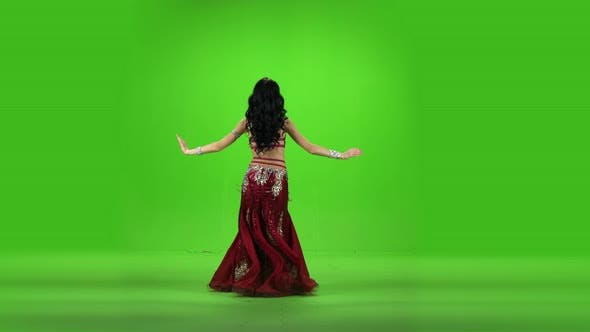 Thumbnail for Arab Dancer Performs Belly Dance on Stage. Green Screen.
