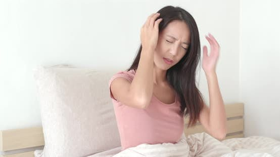 Thumbnail for Woman suffer from headache on bed