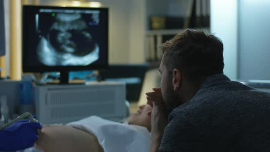 Thumbnail for Couple Watching Ultrasound Image of Future Child