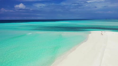 Wide above clean view of a sunshine white sandy paradise beach and blue sea background