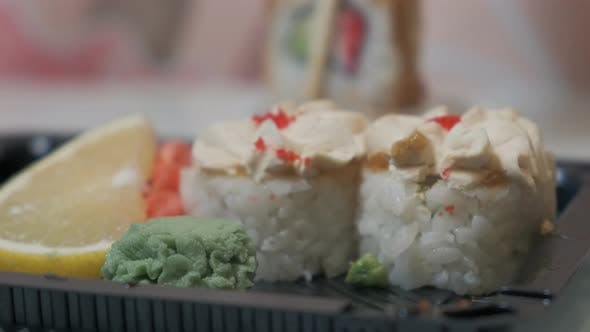 Thumbnail for Chopsticks Dipping Sushi Roll Into Soy Sauce