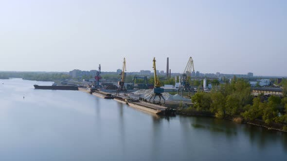 Thumbnail for Port Cranes On A River Bank