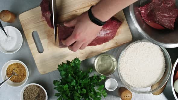 Thumbnail for Chef Cutting Meat with Knife