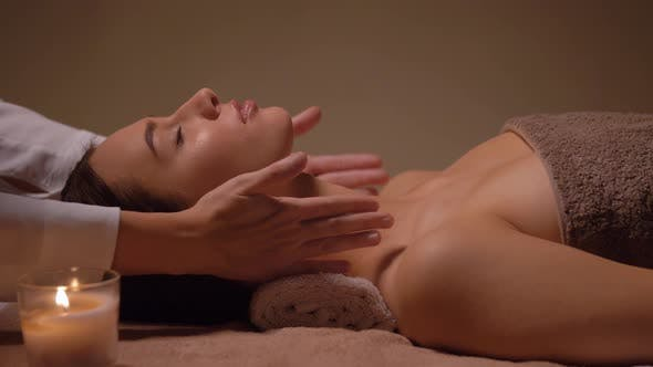 Thumbnail for Woman Having Face and Head Massage at Spa