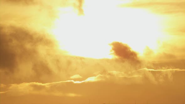 Thumbnail for A  of the Sun Rising and Setting on the Clouds