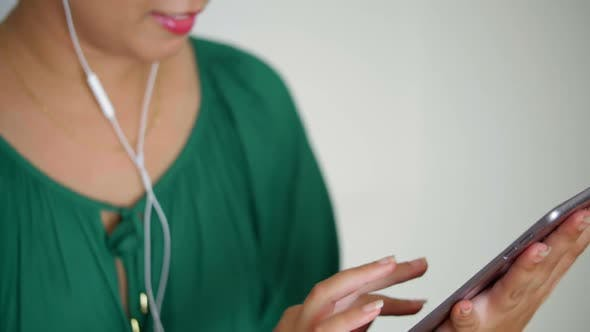 Thumbnail for Woman Using Tablet and Headphones