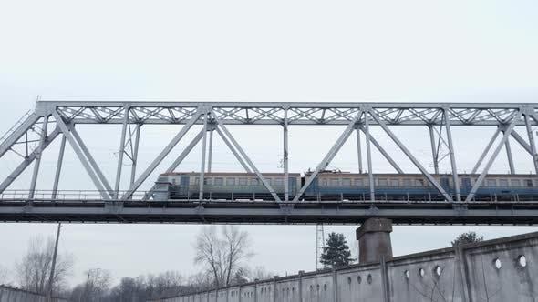 Thumbnail for Electric Passenger Train Crosses a Railway Bridge