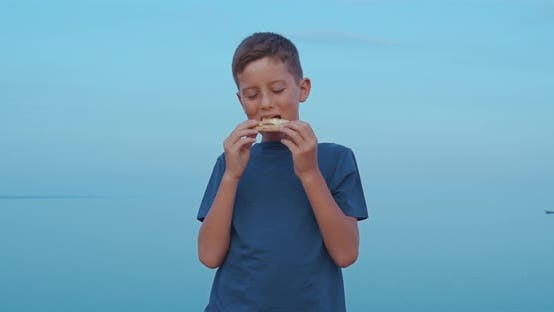 Thumbnail for The Boy Is Eating Pizza Outdoor