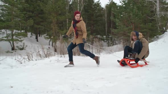 Thumbnail for Excited Men Sledding at Winter Day