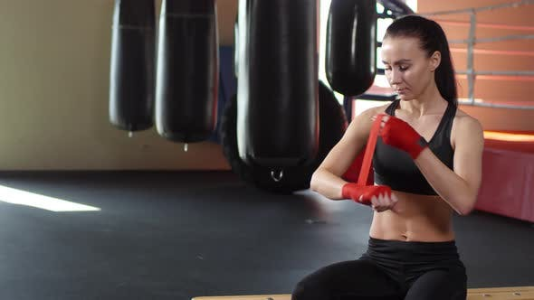 Thumbnail for Young Woman Wrapping Hands for Boxing