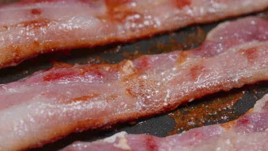 Thumbnail for Fry bacon in pan in kitchen for breakfast