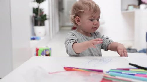Young Girl Drawing at Home with Felt Tips