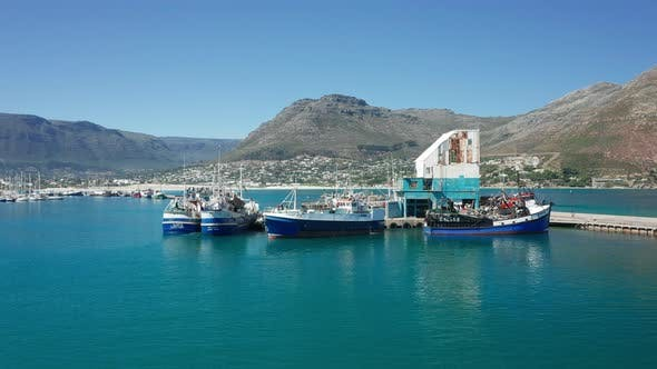 Thumbnail for Marina with Fishing Boats Docked and the Mountain Range
