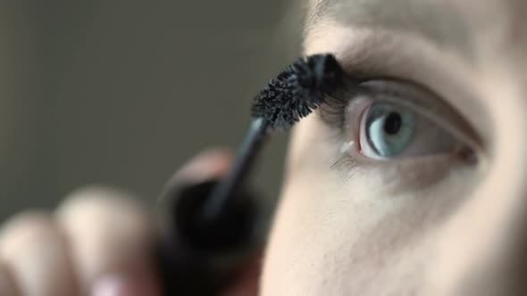 Thumbnail for Plus Size Model Putting on Mascara and Volumizing Eyelashes, Make-Up and Beauty