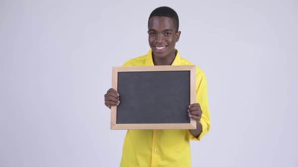 Thumbnail for Young Happy African Businessman Holding Blackboard