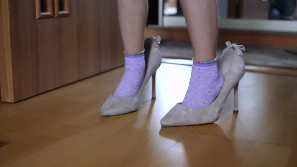Thumbnail for Legs of Small Girl Child in Adult Shoes with Heel