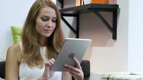 Using Tablet for Browsing Online, Young Girl