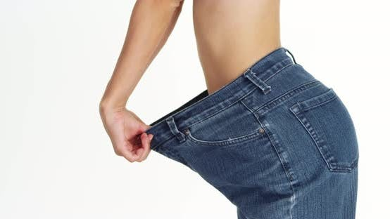Thumbnail for Skinny woman wearing big jeans