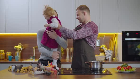 Thumbnail for Happy Same-sex Family with Baby Bonding in Kitchen