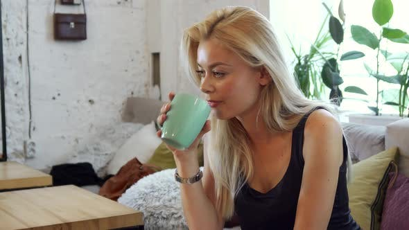 Thumbnail for The Blonde Is Drinking Coffee