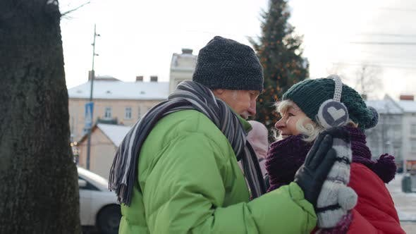 Happy Elderly Couple Grandmother Grandfather Tourists Traveling in European City Near Christmas Tree