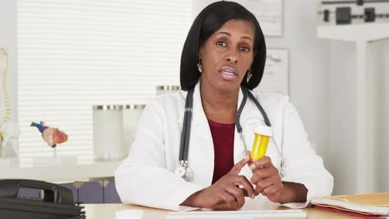 Thumbnail for Senior black doctor talking about medication bottle to camera