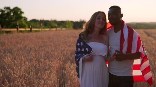 Interracial Couple with USA Flag