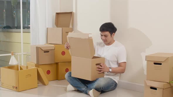 guy opening unpacking cardboard boxes and easy and fast service commerce delivery into big modern.