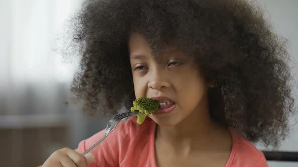 Thumbnail for Funny African American Girl Eating Broccoli with Disgust, Healthy Food, Dieting