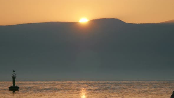 Thumbnail for The sun setting in Rijeka Bay