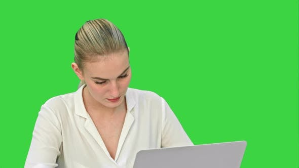 Thumbnail for Young Blonde Businesswoman Working on Laptop Computer on a Green Screen, Chroma Key