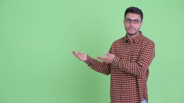 Thumbnail for Stressed Young Hispanic Hipster Man Showing Something and Giving Thumbs Down