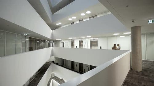 Corporate Workers In Modern Architecture Interior