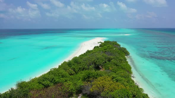 Daytime above clean view of a white sandy paradise beach and blue ocean background in colorful 4K