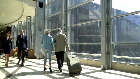 Thumbnail for Two Seniors Walking with Suitcase
