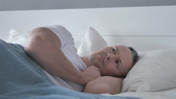 Thumbnail for Pensive Gray Hair Man Thinking While Lying in Bed