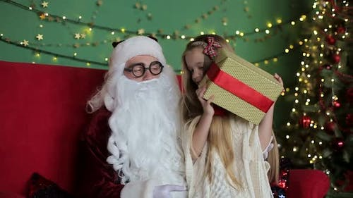 American Santa Claus gives gifts to obedient children. Christmas holiday