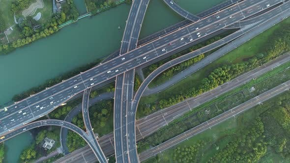 Thumbnail for Aerial Drone View of Highway Multi-level Junction Road with Moving Car at Sunset. Active Movement of