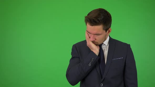 Thumbnail for A Young Handsome Businessman Acts Sad - Green Screen Studio