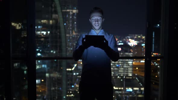 Thumbnail for Young Attractive Successful Male Entrepreneur Using Digital Tablet Computer