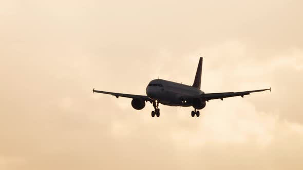 Airliner Silhouette in Golden Sunset Sky